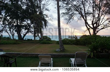 Lawn Chairs In Beach Yard Looking Towards Early Morning Sunrise