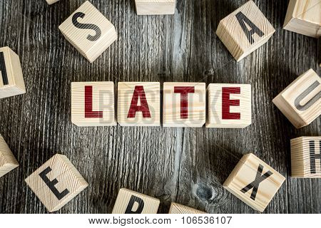 Wooden Blocks with the text: Late