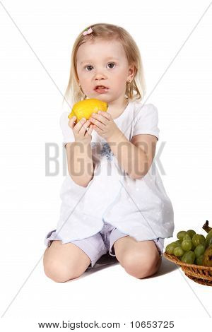 Cute Child With Fruits