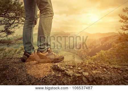 Men stay in Mountain  footwear on the beautiful view.