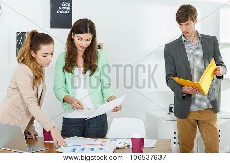Inventive Workers Preparing Presentation