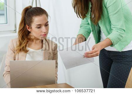 Manager Explaining Something To Worker