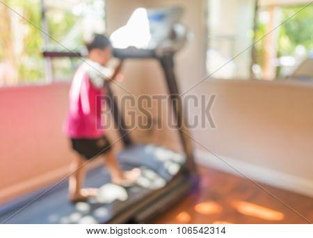 Boy Running Treadmill At Home