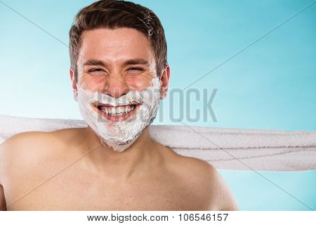 Happy Young Handsome Man With Shaving Cream Foam.