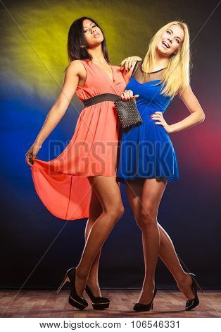 Two Dancing Women In Dresses.