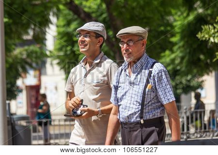 Father And Son Wearing Caps.