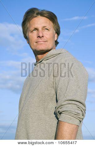 A pensive looking forties man.