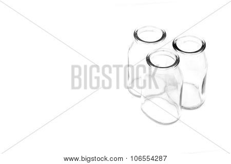 Group of three empty glass bottles use for contain medicine