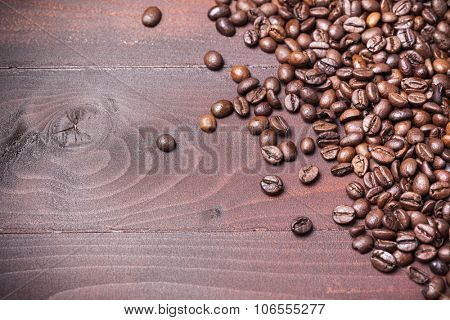 Coffee beans on aged wooden table