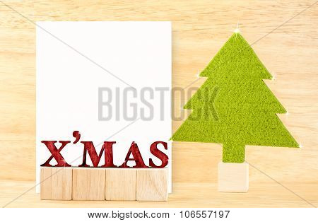Red X'mas Word And Blank Postcard With Green Christmas Tree In Wooden Room,holiday Concept, Leave Sp