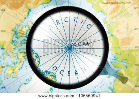 Map, Magnifying Glass And Arctic Ocean On The Focus