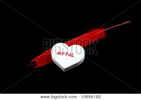 Red feather and white heart