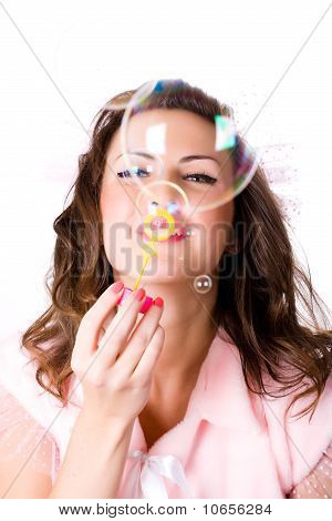 Pretty Girl Blowing Soap Bubbles