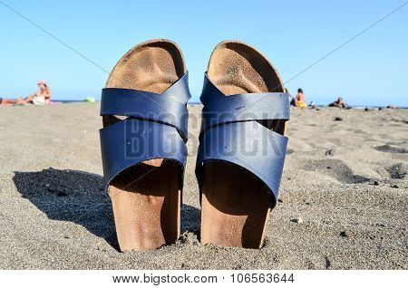 Slippers on the Sand Beach