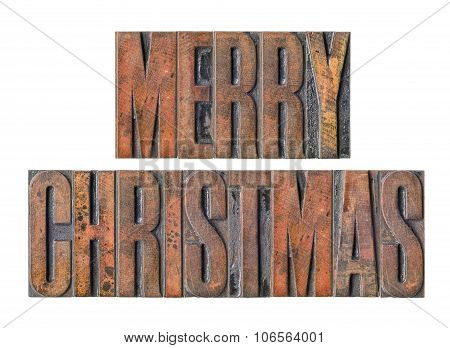 Antique Letterpress Wood Type Printing Blocks On A White Backgound - Merry Christmas