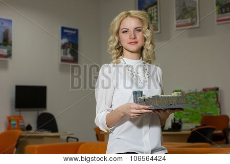 Girl Real Estate Agent Holding A Model Home