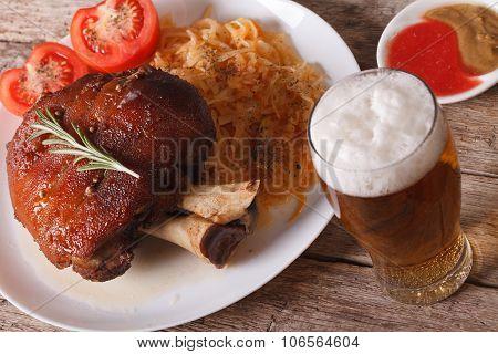 Baked Pork Shank And Sauerkraut Closeup And Beer. Horizontal