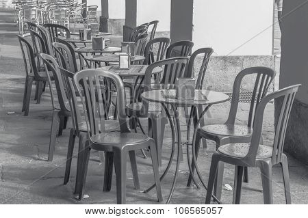Empty Bar, Bistro Or Cafe Terrace With Plastic And Metal Chairs And Tables Outdoor