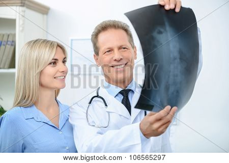 Professional doctor talking with his patient
