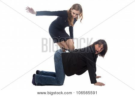 Woman beating man in black jacket