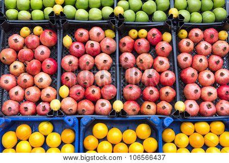 Pomegranates, apples and lemons