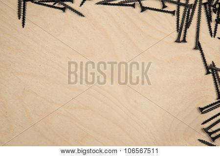 Screws on top and right of wood plate