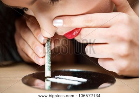 Young girl taking drugs
