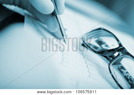 Ecg And Glasses On The Table Doctor