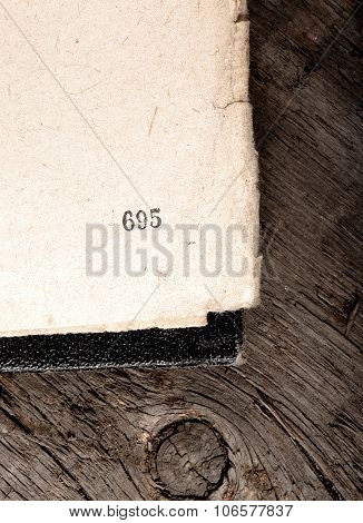 Old Shabby Book Apened On Obsolete Wood Background