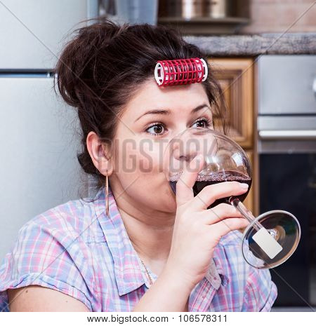 Woman In The Kitchen Drinking Wine