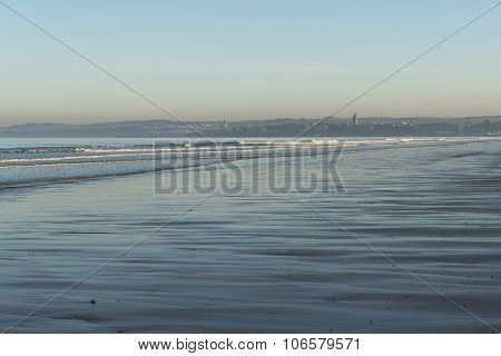 A  seascape vista with St Andrews in the background in Scotland