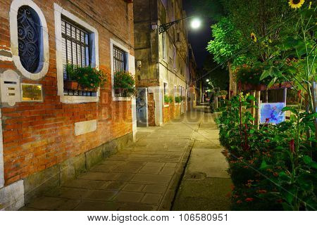 VENICE, ITALY - SEPTEMBER 14, 2014: Venice at night. Venice is a city in northeastern Italy sited on a group of 118 small islands separated by canals and linked by bridges