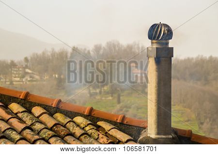Old Smoking Chimney On The Roof On A Foggy Autumn Day
