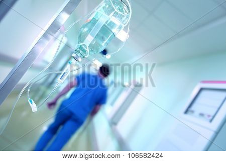 Drip Against A Blurred Hospital Corridor