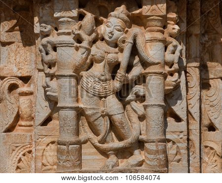 Silhouette Of Hindu Woman On The Ancient Relief Of Temple In India