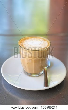 Coffee in a glass on a stainless steel table