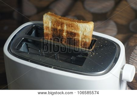 White Dirty Toaster And Burned Toast (selective Focus, Dark Tone)