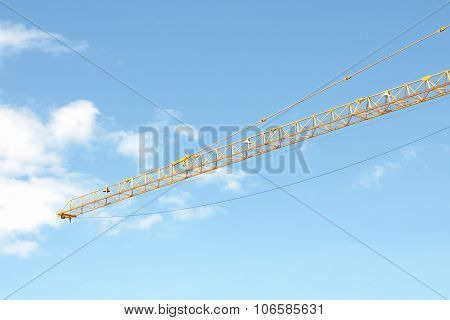 Yellow Industrial Crane And Blue Sky On Construction Site, Sea Port