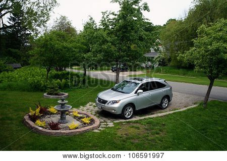 Lexus in Front of a Fountain