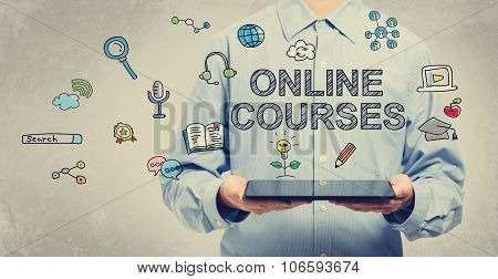 Online Courses Concept With Young Man Holding A Tablet