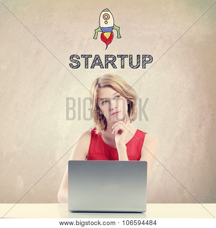 Strat Up Concept With Woman Working On A Laptop