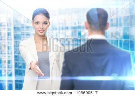 Portrait of business woman handshake gesturing with businessman, blue background. Concept of leadership and success