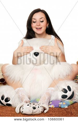 Pretty Girl Plays With A Teddy Bear