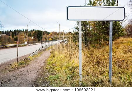 Empty Roadsign Stands Near Rural Highway