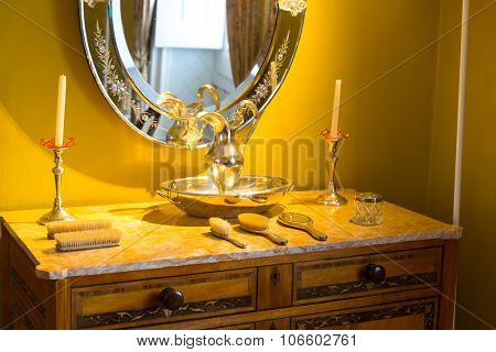 Retro interior with table with vintage combs, mirror on the wall
