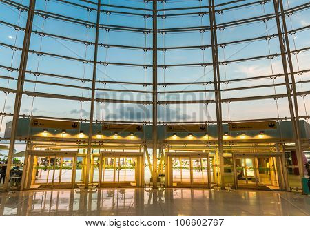 Airport interior with glass wall and four doors
