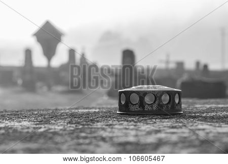Candle Lid In The Cemetery