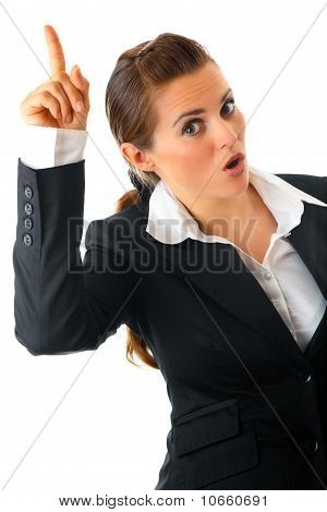 Modern business woman with rised finger