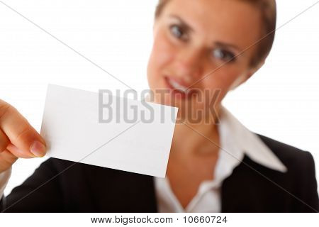 Smiling modern business woman holding blank business card