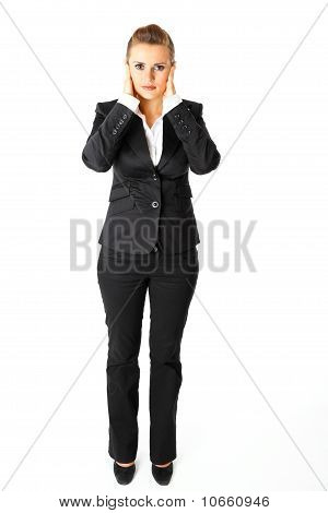 Full length portrait of modern business woman with hand on ears
